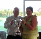 Lady Captain presenting the handsome trophy to the winning Seniors Captain